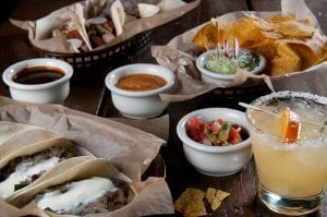 Selection of soft tacos, chips, and a margarita