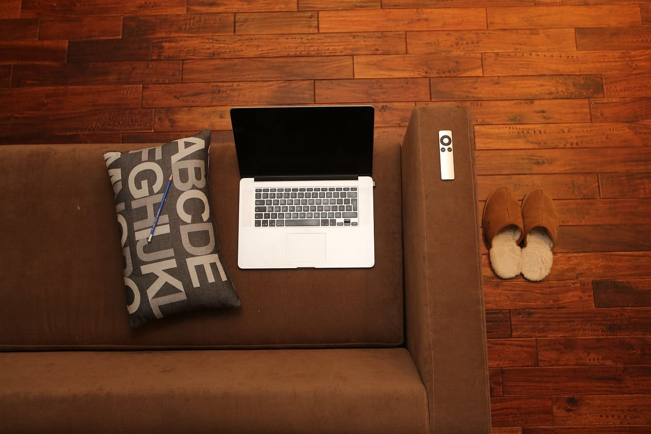 Remote business laptop placed on a couch
