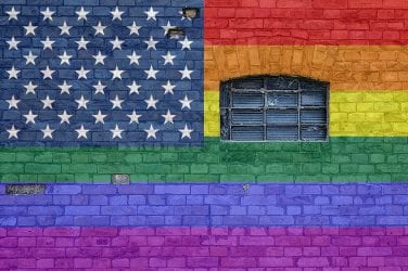 LGBTQ colored flag placed as wall graffiti