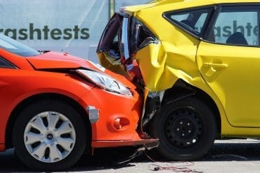 Red car collides with yellow vehicle