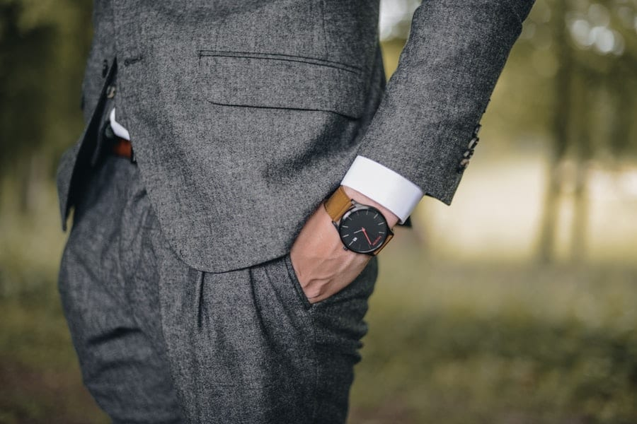 man wearing a suit and a watch